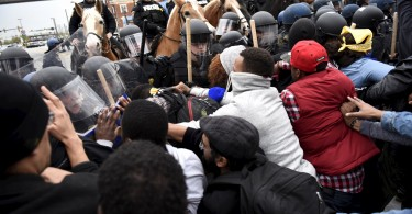 Image: Demonstrators confront police near Camden Yards during protest against the death in police custody of Freddie Gray in Baltimore