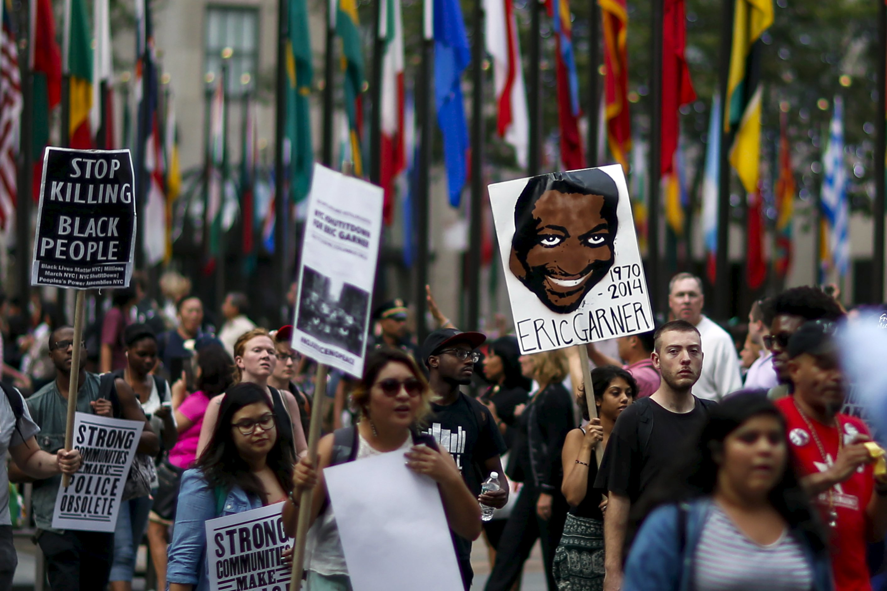 Protester march for Eric Garner who was killed one year ago by police in New York July 17, 2015. Family and supporters on Friday marked the anniversary of the police killing of Eric Garner with rallies and vigils demanding police reforms and justice in the controversial case. REUTERS/Eduardo Munoz